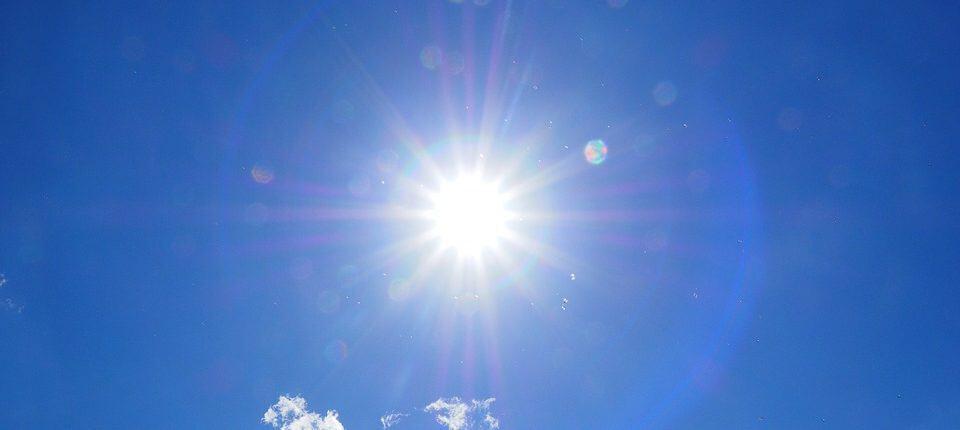 Blue sky with blinding sun