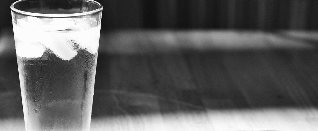A picture showing glass of water with ice
