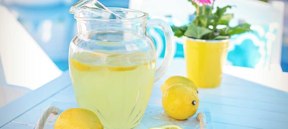 Picture showing jug of lemonade and lemons