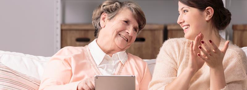 senior with carer, tablet
