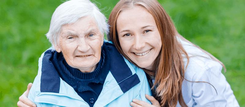 elderly lady with female carer