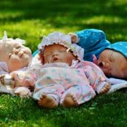 dolls on a grass