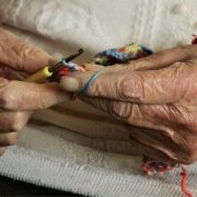 Elderly knitting in care home