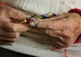 Elderly knitting in care home