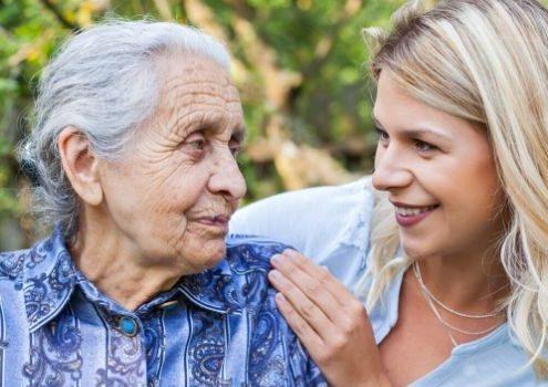 Carer and elder smiling