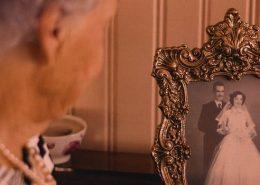 Dementia patient looks at photos